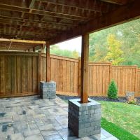 backyard wood fence bricks patio