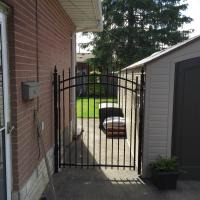 Iron Gate Against Garage