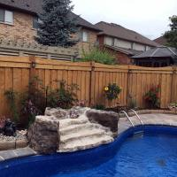 wood fence pool fountain